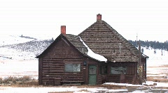 A large addition tacked on to a small log cabin - stock footage