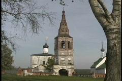 Large trees make a lovely foreground for the Kideksha Church in Russia. Stock Footage