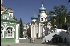 A pan shot of people walking toward the Sergiev Posad Church in Russia. Stock Footage