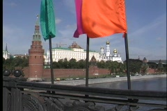 Colorful flags wave in the breeze with the Moscow River in the foreground of the Stock Footage
