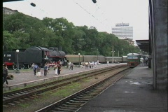 A green trans Siberian railway passenger train pulls into a Russian station. Stock Footage