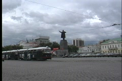 A pan of a busy Russian street with busses and vehicles passing the Stock Footage