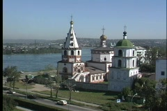 An aerial view of the Irkutsk Church in Russia overlooking a large body of Stock Footage