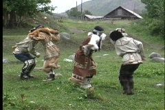Natives dance near a village on the Kamchatka Peninsula in Russia. Stock Footage