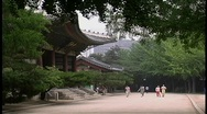 Pedestrians stroll near the Doeksugnung Palace in Seoul, South Korea. Stock Footage