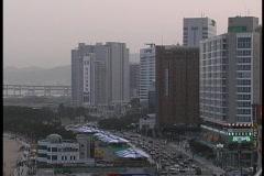 Skyscrapers overlook Haeundae Beach in South Korea. Stock Footage