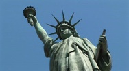 Stock Video Footage of The camera looks up at a towering Statue of Liberty, set against
