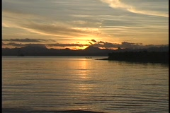 Water moving along the shore in a golden-hour shot of one of the South Pacific Stock Footage