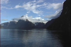 Point-of-view shot from a boat, of rugged mountain peaks, in Milford Sound, New Stock Footage