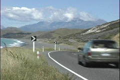A medium shot driving along a scenic coastal highway in New Zealand. Stock Footage
