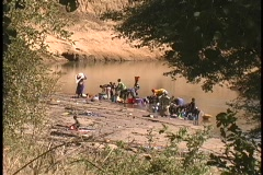 Women wash clothes in the Niger River in West Africa. Stock Footage