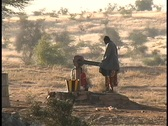 Stock Video Footage of Native South African woman struggles to pump water from a well.
