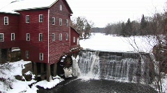 Stock Video Footage of Ice immobilizes an old gristmill's waterwheel