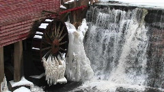 A close-up of water flowing past a gristmill Stock Footage