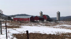 Long shot of farm buildings in winter Stock Footage