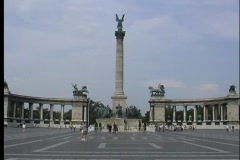 A medium-shot of tourists walking near Heroes' Square in Budapest, Hungary. Stock Footage