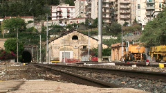 A train passes through a train yard and town. Stock Footage