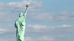 A time lapse of clouds moving over the Statue of Liberty. Stock Footage