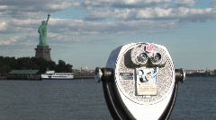 A tourist telescope overlooks the Statue of Liberty. Stock Footage