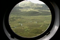 An aerial view of mountains and valleys near Kamchatka, Siberia, from a Stock Footage