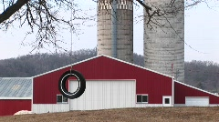 A tire swing, a red barn, and twin silos Stock Footage