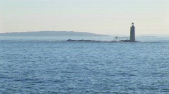 The Portland Head Lighthouse sits on a small island off the Stock Footage