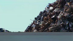 Vehicles drive pass a high pile of waste. Stock Footage