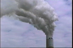 Smoke pours out the top of an industrial smokestack. Stock Footage