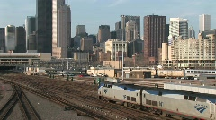 Two trains head into downtown Chicago Stock Footage