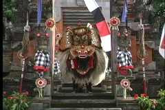 A Balinese dancer performs on the steps of a city in Indonesia. Stock Footage