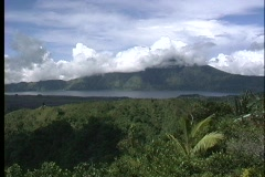 Clouds obscure the view of the peak of Gunung Agung volcano in Bali. - stock footage