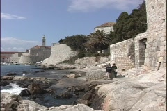 Cliffs and stone walls surrounding Dubrovnik, Croatia's coastal city. Stock Footage