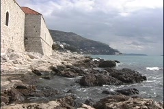 Houses along the Dubrovnik coast meet with the rocky shoreline. Stock Footage