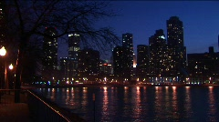The Chicago skyline after dark with lights reflected in Lake Michigan Stock Footage