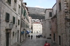 A medium shot of people walking down the narrow streets of Dubrovnik, Croatia. Stock Footage