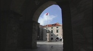 Viewed through an archway, the Croatian flag moves gently in the wind. Stock Footage