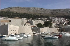 Pan of boats in a small harbor in Dubrovnik, Croatia. Stock Footage