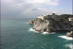 Waves crashing against the cliffs near the oceanfront community of Dubrovnik, Stock Footage