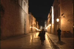 People walk along narrow streets in Dubrovnik, Croatia at night. Stock Footage