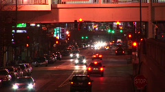 A busy downtown scene at night with congested traffic Stock Footage