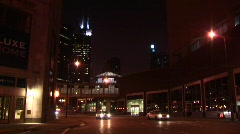 Nightime urban scene with taxis and other vehicles Stock Footage
