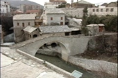 A medium-shot of an arched bridge built over a canal in Dubrovnik, Croatia. Stock Footage