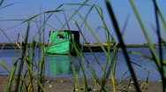 Oyster boat, green, through grass Stock Footage
