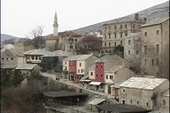 A medium-shot of colorful houses on a Bosnian hillside. Stock Footage