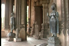 Buddhist statues stand at the entrance to a temple in Laos. Stock Footage