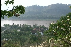 A birds-eye view of a house nestled near the banks of a large river. Stock Footage