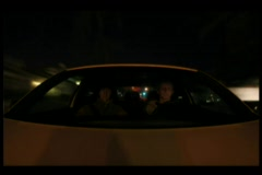 Time-lapse of two young men driving through a city in a car. Stock Footage