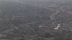 A aerial shot of a freeway and surrounding metropolitan area Stock Footage