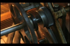 The gears of a player piano spin as it is played. Stock Footage