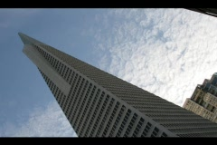 Time-lapse of clouds passing above the TransAmerica Pyramid in downtown San Stock Footage